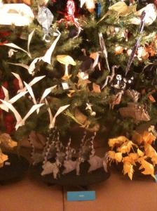 The base of the AMNH Origami Tree features groups of ring-tailed lemurs and flock of doves