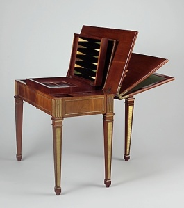 David Roentgen's Game Table (ca. 1780–83). Oak, walnut, veneered with mahogany, maple, stained maple, holly, stained holly; felt; leather, partially tooled and gilded; iron and steel fittings; brass and gilt bronze mounts. Source: Metropolitan Museum, Pfeiffer Fund, 2007.