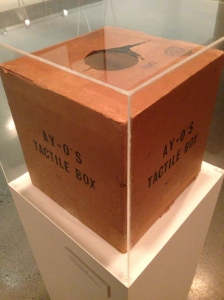 Installation view of Ay-O's Tactile Box (No. 25) (1964). You put your hand into the hole to feel what's inside. Source: Jonas Mekas Visual Arts Center.