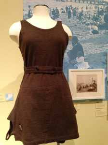 Installation view of woolen bathing suit (1905) and images of the 1890s Staten Island shore