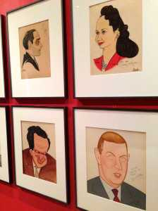 Installation view of Alex Gard's portraits at Sardi's – Lorenz Hart, Dorothy Kilgallen, Al Capp, and John McClain. Collection: NYPL