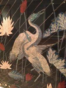 Installation view of woman's cotton sarong incorporating Chinese-style cranes, probably from the workshop of Mrs. Wilemse (1890-1910). Central Java, Indonesia
