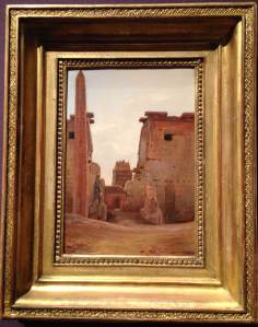Installation view of The Gate to the Temple of Luxor (1836) by La Bouëre. After Napolean invaded Egypt, the exotic Middle East became all the rage. The missing obelisk ended up in the Place de la Concorde.