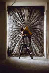 Jay DeFeo working on what she then called The Death Rose, 1960. Photo: Bert Glinn. © Bert Glinn/Magnum Photos