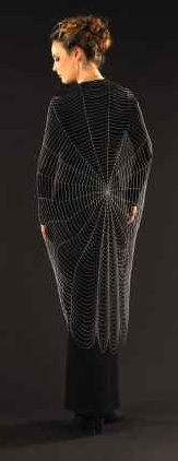 Model wearing The Big Spiderweb, No. 2 made of sterling silver in 2005 by Lucie Heskett-Brem, The Gold Weaver. Photo: Louis Brem