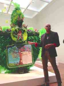 "Alonzo Wilson explains how the cycle of life and the seasons are reflected on the beaded apron of the ""Big Chief: Tree of Life"" costume."