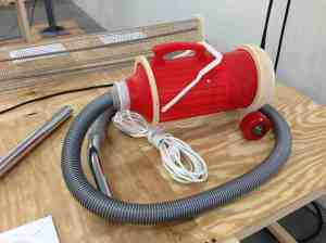 Open-source vacuum assembled from downloadable instructions, a red thermos, hardware store items, and 3D printed parts