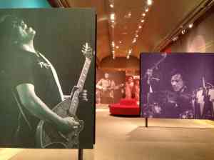 Installation view with photos of Stevie Salas, Jessie Ed Davis, and Randy Castillo.