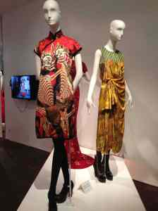 Vivienne Tam's 2007 embroidered/quilted silk cheongsam and Peter Som's 2010 chartreuse and yellow silk dress.