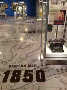 The floor map and vitrines with items associated with Green-wood's most famous