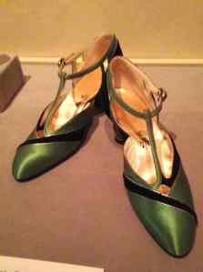 Green silk and black velvet evening shoes worn by fashionable women in the Twenties, lent by FIT