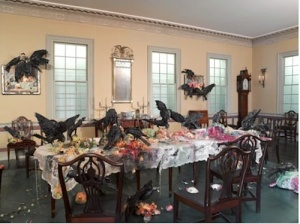 "Hegarty's ""activation"" of the Cane Acres Plantation dining room: Still Life with Peaches, Pear, Grapes and Crows; Still Life with Watermelon, Peaches and Crows; and Table Cloth with Fruit and Crows. Photo: Brooklyn Museum"