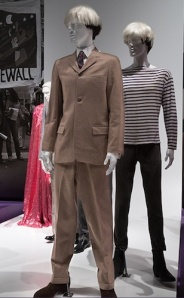 The suit that Andy had made in Hong Kong in 1956 on his first trip abroad compared to his super-hip King of Pop 1960s uniform.