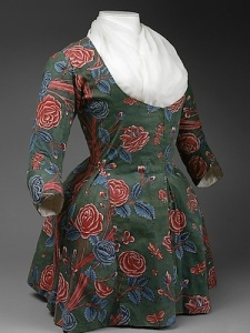 A late-18th century Indian-chintz Dutch jacket that knocked-off a French designer jacket in pink French fabric. Both have similar exotic floral prints. Source: The Met