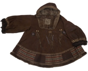 Koryak woman's dancing coat from Kushka, Siberia; fur, hide, bead, cloth, sinew; acquired 1901 by AMNH.