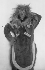 "Striking a pose in an ""Eskimo"" hide, fur, and sinew coat in 1916. Source: AMNH"
