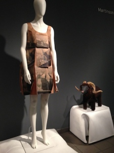 Yeohlee's dress — Shamanistic Printed Prayer Flag Dress from Brown Kraft Paper. Among her whimsical inspirations — a ram carved in 1988 by New Mexico artist Johnson Antonio
