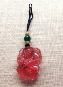 Tiny pendant in the Shape of a Boy, carved and polished tourmaline