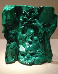 Converse had to have this tiny green malachite sculpture of a teacher seated in a grotto.