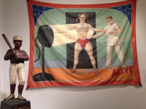 Baseball statue from 114 Centre Street and the sideshow's Radium Girl banner from Chicago in the 1930s