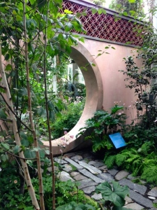 NYBG recreated the evocative Moon Gate from the Rockefeller garden, inspired by their experience of the Forbidden City and designed by Beatrix Farrand