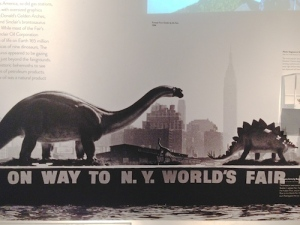 A 1964 New York Times photo of the Sinclair Dinosaur and Stegosaurus passing by the Empire State Building on their way to the Queens fairgrounds