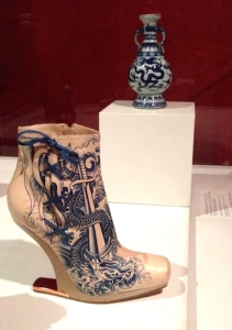 Gaultier's 2012 Nude Tattoo Boot displayed next to its inspiration, a Chinese porcelain Ming vase (1573-1619)
