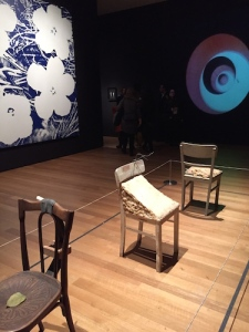 Sturtevant's 1990 vision of Warhol's Flowers alongside her 1968 Duchamp film with interpretations of three Beuys chairs