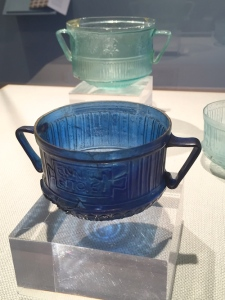 "Two-handled cup, with Ennion's Greek brand (""Ennion made this/it""). Blown glass into mold, 1st c. A.D. Courtesy: Turin museum; other by private collector"