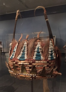 1780 Plains Indian horned headdress assembled from a powerful mix of materials including bison horns, deer and horsehair, porcupine quills, glass beads, wood, metal cones, cotton cloth, silk ribbon, and paint. From the Musée du quai Branly in Paris