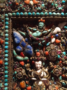 Densely packed diamonds, rubies, emeralds, sapphires, garnets, quartz, pearls, amber, coral, lapis, and turquoise in corner of Birth of the Buddha mosaic (18th-19th c. Nepal)