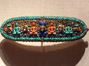 This Forehead Ornament for a Deity is only 8 inches long. Four celestial Buddhas are interspersed with diamonds