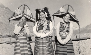 Mrs. Tsarong and two ladies from Tsang wearing special-occasion jewelry and hats as photographed by C. Suydam Cutting in 1937. Courtesy: Newark Museum collection