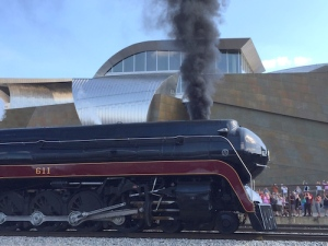 The restored 611 arrives in downtown Roanoke behind the art museum
