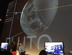 In real time, AMNH astrovisualization guru Carter Emmart notes the moment that humans reached the furthest point of exploration on Pluto on the big screen