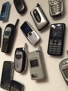 Mobile phones for days – the future of computing. The curators put these up with Velcro so visitors could feel them.