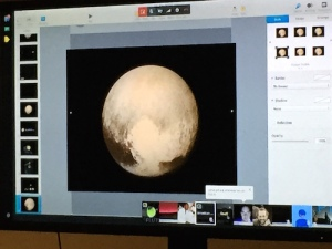 """Pluto's photo from earlier in the week appears on the Google Hangout, showing the """"heart"""" area"""