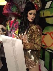 "Wielding ""the list"" in a 2008 Jean-Paul Gaultier jacket and Patricia Fields hat"