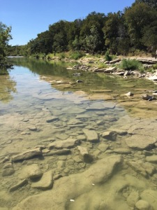 Sauropod footprints underwater at the Paluxy River, Glen Rose, Texas