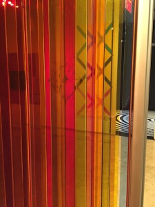 Other works seen through the1965-2009 plexiglass and steel piece by Carlos Cruz-Diez