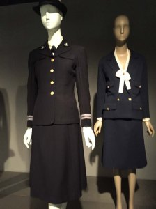 Mainbocher's well-cut 1942 uniform for the U.S. Navy W.A.V.E.S. (1942) and Chanel's chic military-inspired ensemble (1960)
