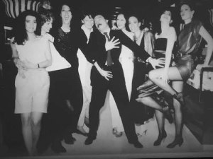 "Photo of Antonio surrounded by ""Antonio's girls"" in the 1980s Installation views of ""Antonio Lopez: Future Funk Fashion"" El Museo del Barrio New York, New York June 14 – November 27, 2016"