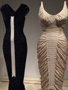 "Azzedine Alaia's 1994 slinky, downy knit dress next to its inspiration, ""La Sirene"" (1951-52) by legend Charles James"