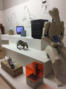 Installation view of The Universal Addressability of Dumb Things (Machine), with costume, Lego ship, copy of a 1959 Soviet space dog suit